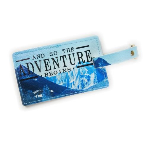 matkalaukun nimikyltti seikkailu sininen